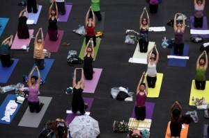 Breast Cancer patients, survivors particiapte in an outdoor yoga event.