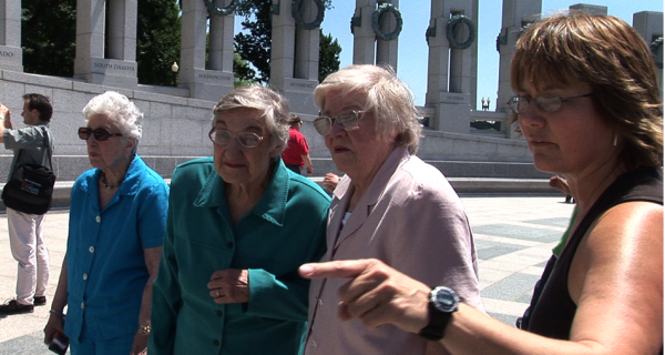 LeAnn Erickson (far right) visits the World War II memorial with some of the women featured in her documentary.