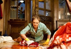 Norma cleans up blood.